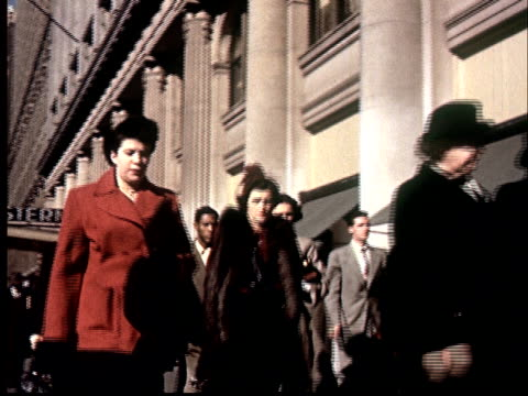"""1950s FILM MONTAGE MS People walking on sidewalk at East 51st Street/ MS People walking/ New York, New York"""