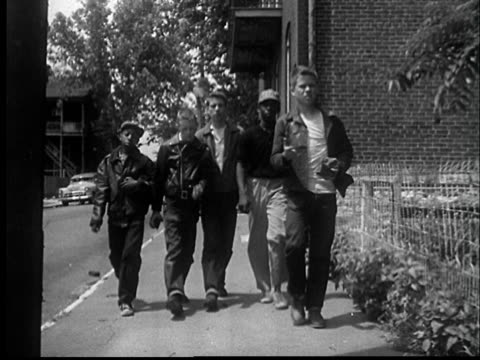 """1950s ws five boys about walking up sidewalk carrying bricks moving past camera/ st. louis, missouri/ audio"" - hooligan stock videos & royalty-free footage"