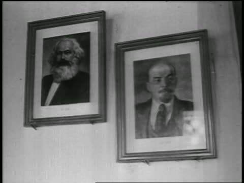 b/w 1950s pan from framed portraits of marx lenin on wall to soviet flag / newsreel - former ussr flag stock videos & royalty-free footage
