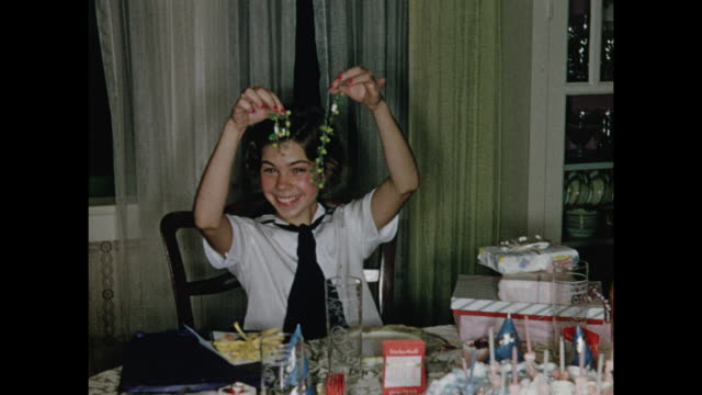 1950s girl opening birthday presents HOME MOVIE