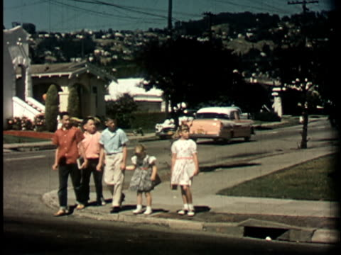 1950s WS, PAN, Group of children crossing street, Berkeley, California, USA
