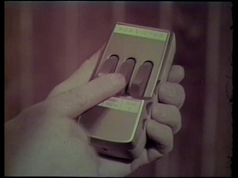 1950s cu hand pushing button on remote control - remote control stock videos & royalty-free footage