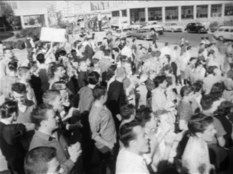 b/w 1950s high angle crowd of people clapping at prosegregation rally / new orleans low angle / newsreel - segregation stock videos & royalty-free footage