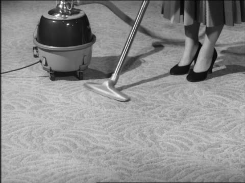 b/w 1950s high angle feet of woman in heels vacuuming carpet - stay at home mother stock videos & royalty-free footage