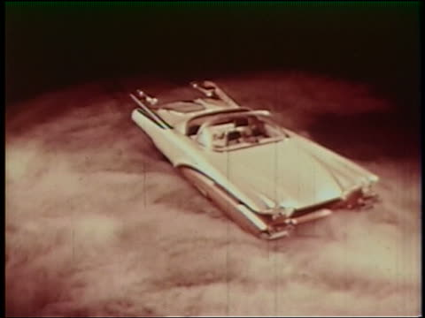 1950s high angle futuristic sports car spinning on smoky platform