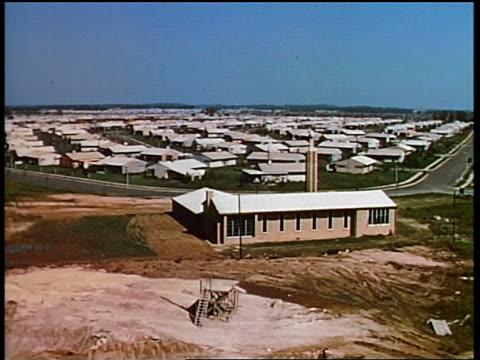 1950s high angle long shot large suburban neighborhood with many houses / levittown, pennsylvania - levittown pennsylvania stock videos and b-roll footage