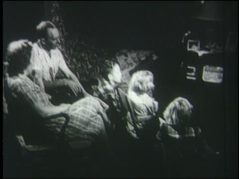 b/w 1950s high angle mother, father + three children sit in chairs watching television - 1950 stock videos and b-roll footage