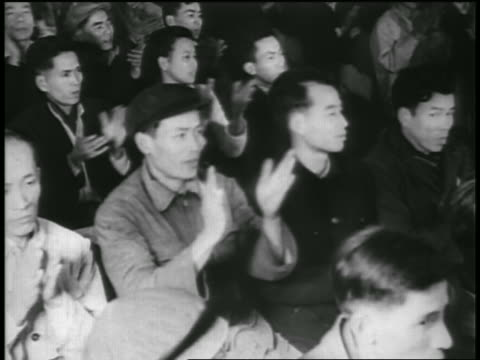 b/w 1950s high angle young asian people in audience clapping / communists / north vietnam - north vietnam stock videos and b-roll footage