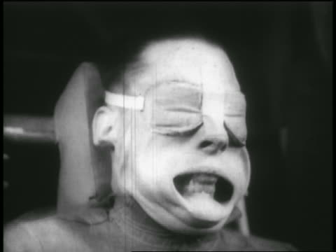 B/W 1950s HIGH SPEED close up man's distorted face in g-force experiment in wind tunnel / newsreel