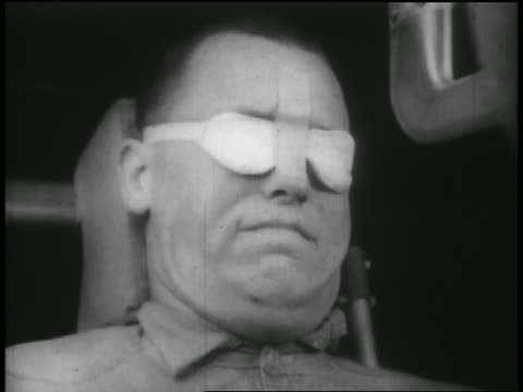 b/w 1950s high speed close up man's distorted face in g-force experiment in wind tunnel - distorted stock videos and b-roll footage