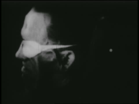 B/W 1950s HIGH SPEED close up PROFILE man's distorted face in g-force experiment in wind tunnel