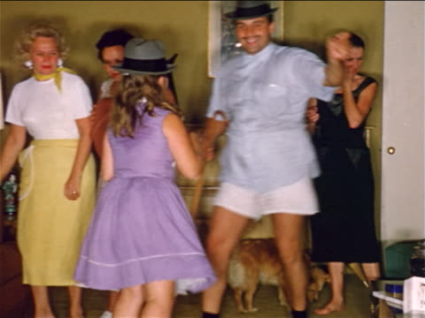 1950s home movie family + dog in living room dancing + acting silly - underwear stock videos & royalty-free footage