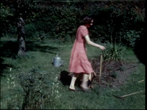 1950s housewife tends garden - stay at home mother stock videos & royalty-free footage