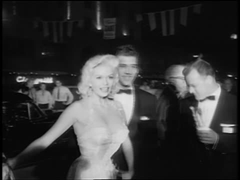 b/w 1950s jayne mansfield and husband mickey hargitay being interviewed upon arrival at black tie event - mickey hargitay stock videos & royalty-free footage