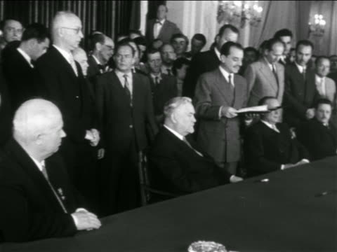 B/W 1950s Khrushchev Nikolai Bulganin Marshal Tito sitting at table as others stand behind them