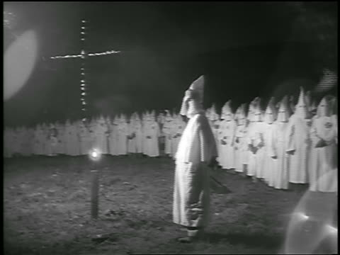 b/w 1950s pan ku klux klan member stands by crowd of members with burning cross in background / georgia - ku klux klan stock videos and b-roll footage