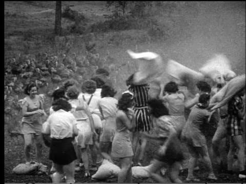 b/w 1950s large group of women having pillow fight in turkey field outdoors - pillow stock videos and b-roll footage