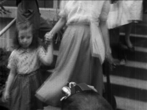 1950s low angle pro-segregation parents leading children down stairs of segregated school / newsreel - social justice concept stock videos & royalty-free footage