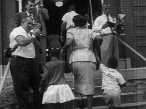 1950s low angle rear view black parents walking their children up stairs into desegregated school - social justice concept stock videos & royalty-free footage
