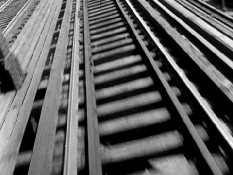1950s low angle train point of view moving along elevated track/ new york city/ audio - railing stock videos & royalty-free footage
