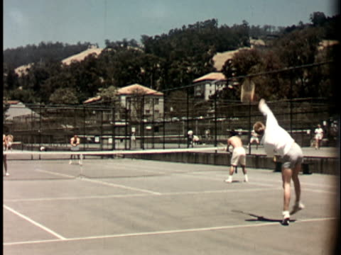 1950s WS, Male students playing doubles tennis on courts of Berkeley University campus, 1950's, California, USA