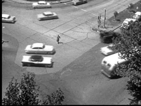 """1950s ha ws man crossing street through heavy traffic/ st. louis, missouri"" - danger stock videos & royalty-free footage"