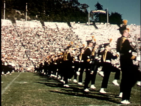 1950s ws, marching band on football field in stadium, berkeley, california, usa - marching band stock videos and b-roll footage