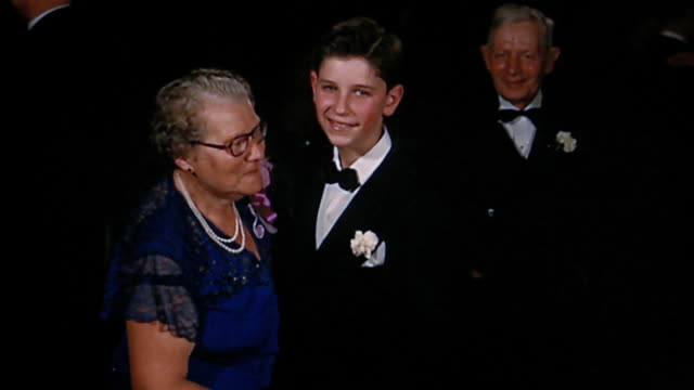stockvideo's en b-roll-footage met 1950s medium shot boy dancing with grandmother - kleinzoon