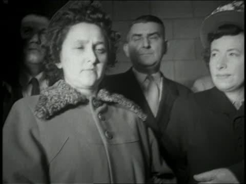 1950s medium shot cam flashing in ethel rosenberg's face outside court / nyc - ethel rosenberg stock videos & royalty-free footage