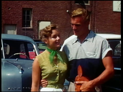 1950s medium shot debbie reynolds and tab hunter posing + smiling with arms around each other - debbie reynolds stock-videos und b-roll-filmmaterial