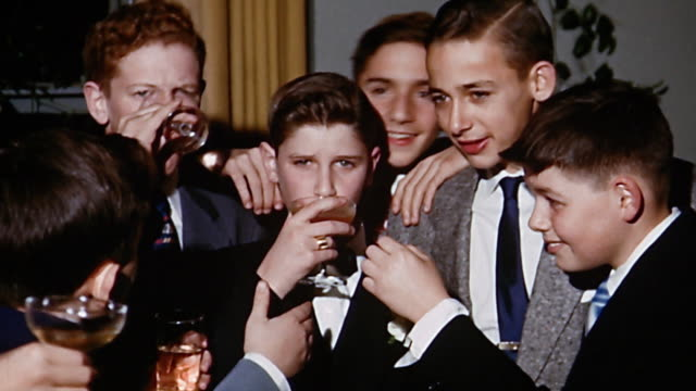 1950s medium shot group of teenage boys drinking at bar mitzvah - alcohol stock videos & royalty-free footage