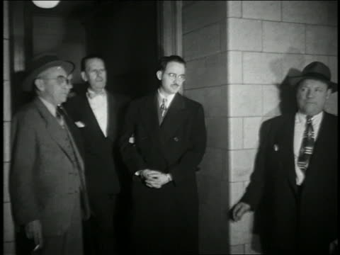 1950s medium shot julius rosenberg in cuffs being escorted from court building / nyc - communism stock videos & royalty-free footage
