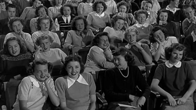 1950s medium shot large group of teenage girls or young women swooning in audience - admiration stock videos and b-roll footage