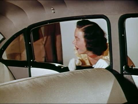 vídeos y material grabado en eventos de stock de 1950s medium shot man and woman smiling + admiring car interior / oohing + ahhhing / audio - incredulidad