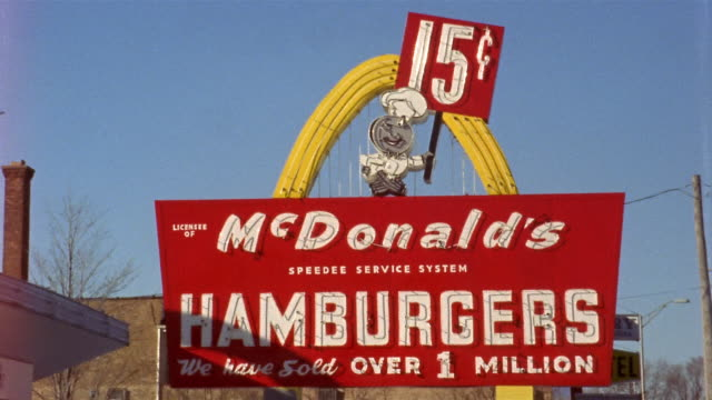1950s medium shot mcdonald's restaurant sign advertising 15 cent hamburgers and over 1 million sold / chicago - mcdonald's stock videos & royalty-free footage