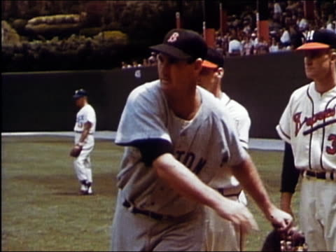1950s medium shot warren spahn, lew burdette and ted williams chatting in the outfield at the all-star game - berretto da baseball video stock e b–roll