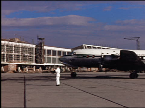1950s men driving mobile stairway past camera with pan am airliner in background / vienna schwechat international airport (flughafen wien-schwechat) / vienna, austria - taxiing stock videos & royalty-free footage