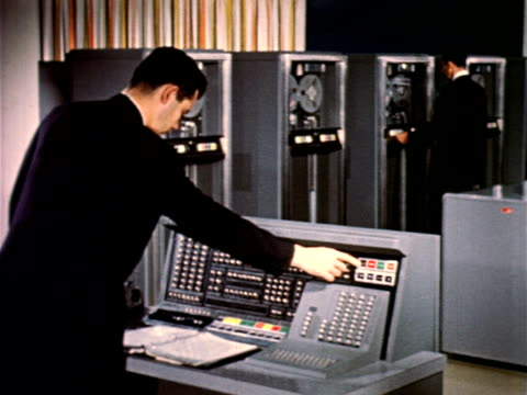 1950s men in dark suits operating ibm 705 computer in computer room - veraltet stock-videos und b-roll-filmmaterial