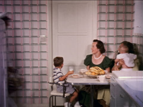 1950s milkman entering kitchen with two women, boy + baby + opening refrigerator / educational