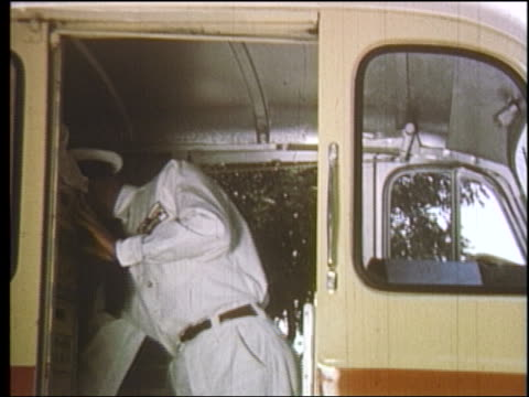 1950s milkman exiting back of truck + smiling / educational - milkman stock videos & royalty-free footage