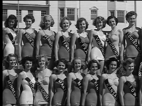 vídeos de stock, filmes e b-roll de b/w 1950s pan miss america contestants in swimsuits standing on risers outside for photo shoot - beauty queen