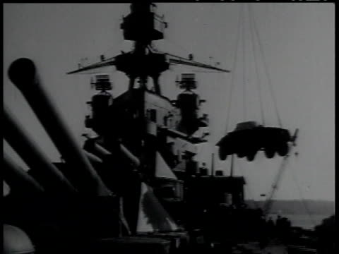 1950s montage armored vehicle being loaded onto a ship with a crane / united sates - armored vehicle stock videos & royalty-free footage
