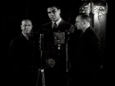 1950s montage boxer max schmeling giving an interview after a fight with joe louis / united states - pesi massimi video stock e b–roll