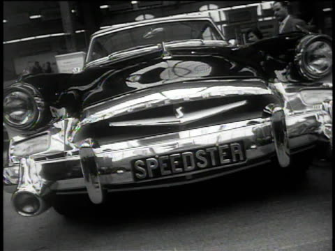 stockvideo's en b-roll-footage met 1950s montage cars on display at auto show / france - 1955