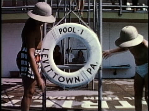 1950s montage community pool / levittown, pennsylvania, united states - buoy stock videos & royalty-free footage