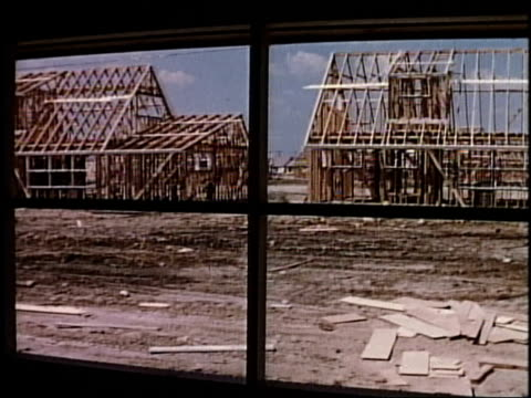 1950s MONTAGE Construction of single family homes / Levittown, Pennsylvania, United States