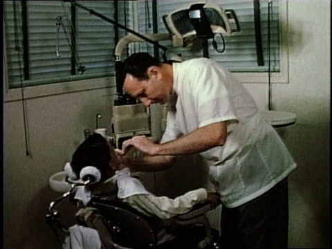 1950s montage dentist working on patient / levittown, pennsylvania, united states - levittown pennsylvania stock videos and b-roll footage