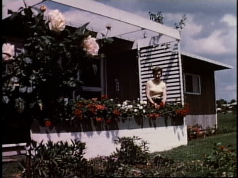 1950s montage gardener tending flowers in arbor / levittown, pennsylvania, united states - levittown pennsylvania stock videos and b-roll footage