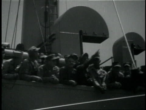 1950s MONTAGE Japanese people crying and waving goodbye to departing soldiers on ship / Japan