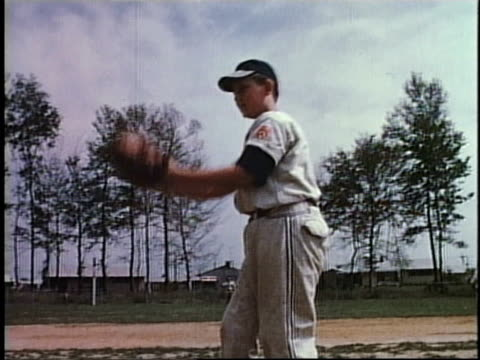 stockvideo's en b-roll-footage met 1950s montage little league baseball game / levittown, pennsylvania, united states - baseball uniform